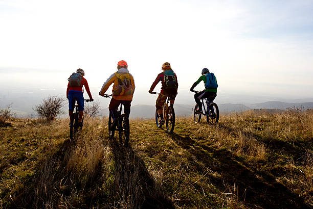 group of mountain bikers ready for a ride - mountain biking stock photos and pictures