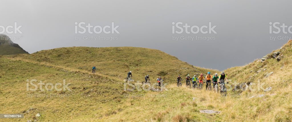 Group of mountainbikers in the Friulian Mountains, Italy. stock photo