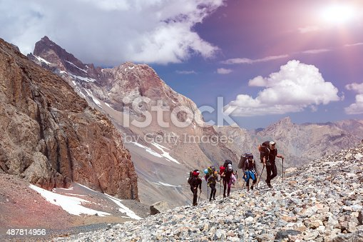 istock Group of Mountaineer Walking on Deserted Rocky Terrain 487814956