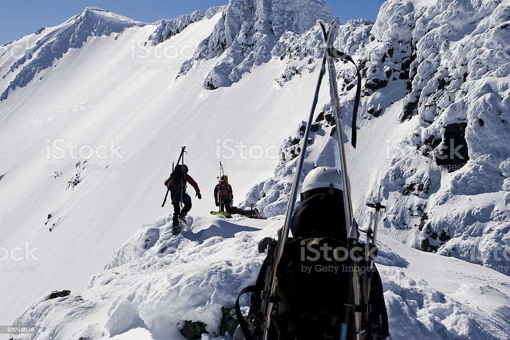 Group of mountaineers heading for the summit. stock photo