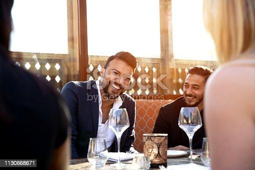 Group of multi ethnic arab friends lunch in a restaurant in Dubai