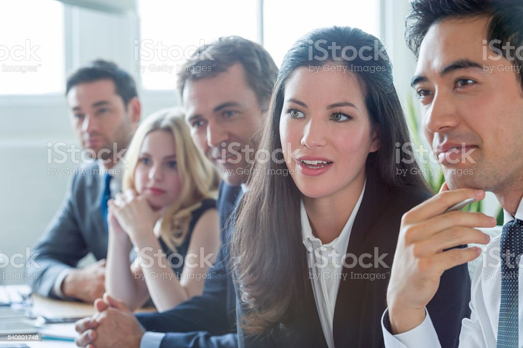 Group of multi ethnic business people listening. stock photo