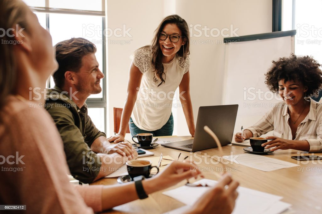 Group of multi ethnic executives discussing during a meeting stock photo