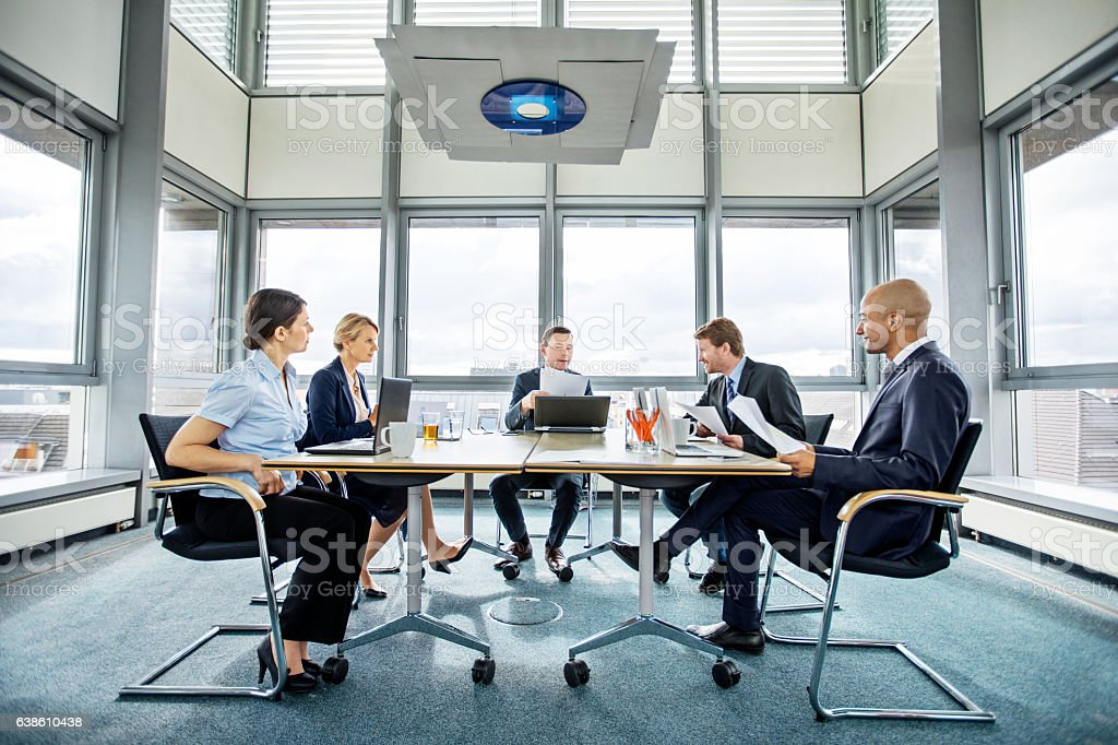 Group of multi ethnic executives in a meeting stock photo