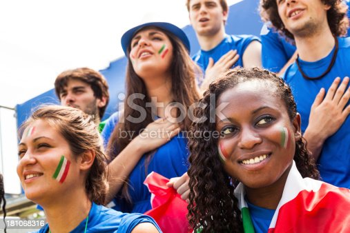 537894724 istock photo Group of Multi Racial Italian Footbal Fan Listening National Anthem 181068316