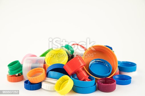 Group of multicolored bottle caps isolated on white background in studio.