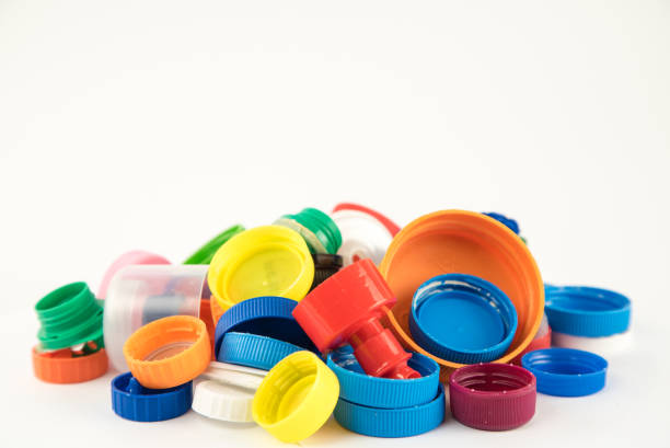 group of multicolored bottle caps - plastic cap stock pictures, royalty-free photos & images