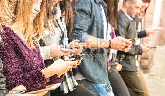 istock Group of multicultural friends using smartphone at university college backyard break - People hands addicted by mobile smart phone - Technology concept with always connected millennials - Filter image 952415044