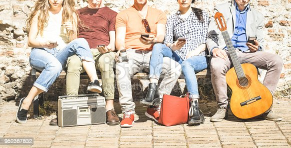 istock Group of multicultural friends using smartphone on urban background - Technology addiction concept in youth lifestyle disinterested to each other - Always connected people on modern mobile smart phone 952387832