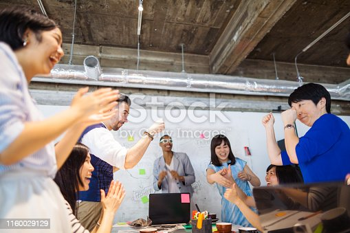 938516440 istock photo Group of multi-ethnic business people celebrating thier business success 1160029129