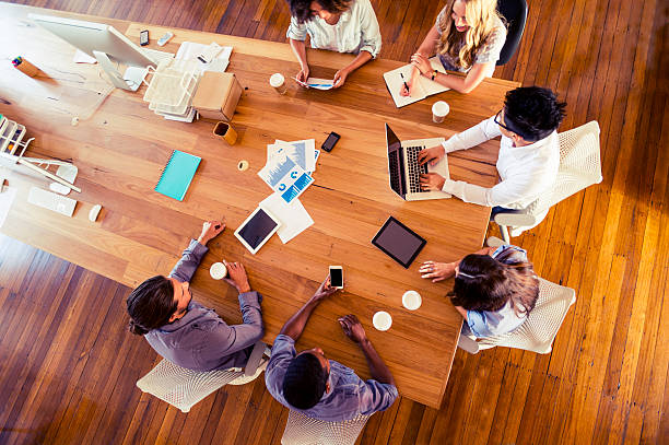 group of multi-ethnic business people meeting - cool attitude stock photos and pictures