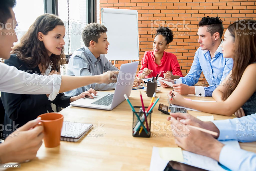 Group of multiethnic business team brainstorming and discussing project in meeting room stock photo