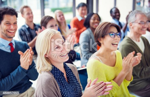istock Group of Multiethnic Cheerful People Applauding 488852553