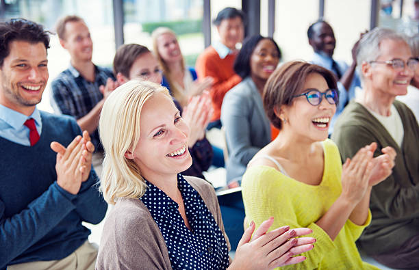 Group of Multiethnic Cheerful People Applauding Group of Multiethnic Cheerful People Applauding press conference stock pictures, royalty-free photos & images