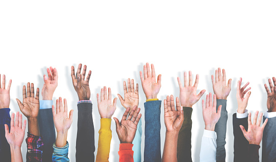 Group Of Multiethnic Diverse Hands Raised Concept Stock Photo - Download Image Now