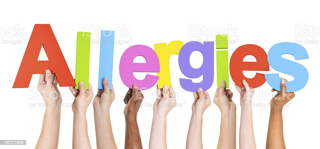 Group of Multiethnic Hands Holding Allergies stock photo