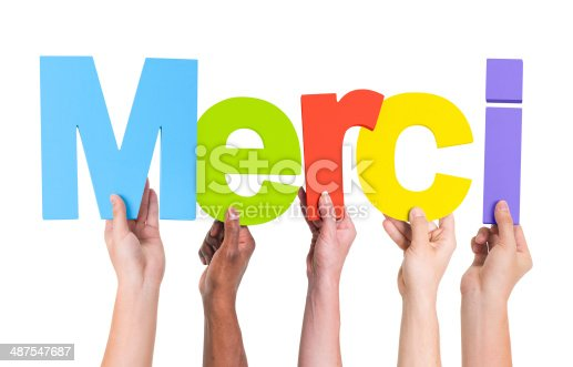 istock Group of Multiethnic Hands Holding Merci 487547687
