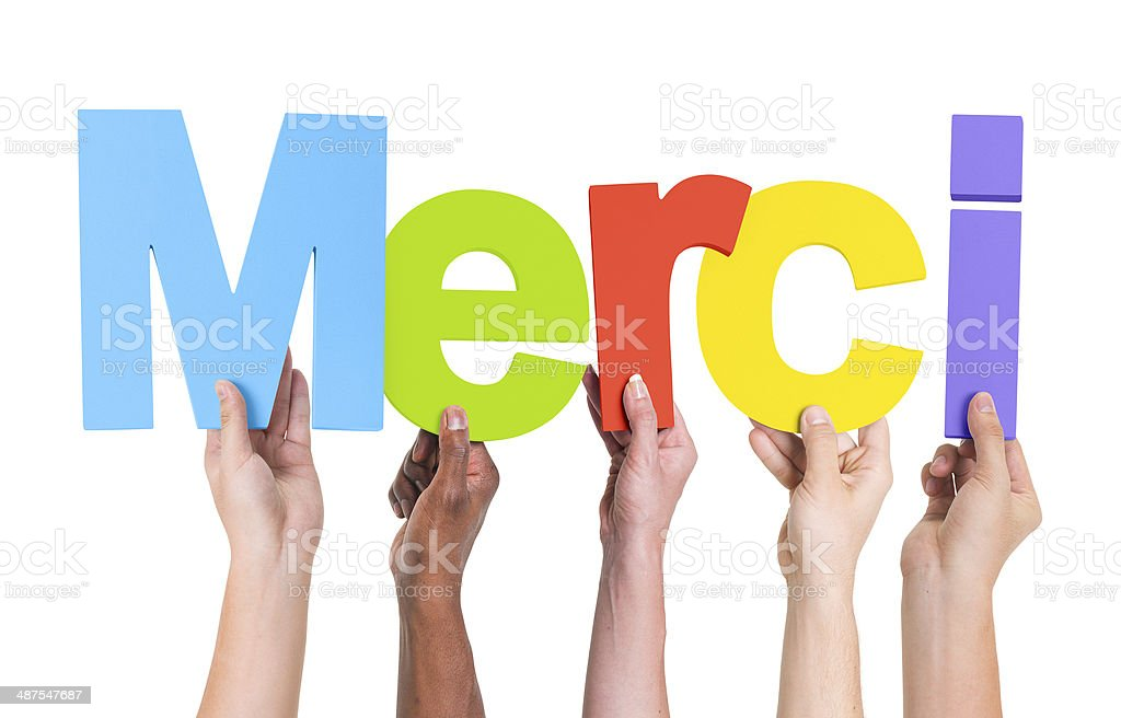 Group of Multiethnic Hands Holding Merci stock photo