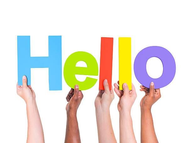"""multiethnische gruppe von hand holding wort """"hallo"""" - hello stock-fotos und bilder"""
