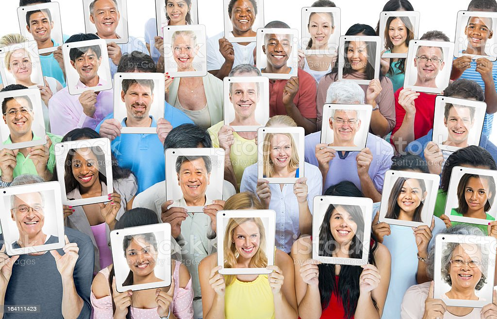 Group of multi-ethnic people holding tablet PCs royalty-free stock photo