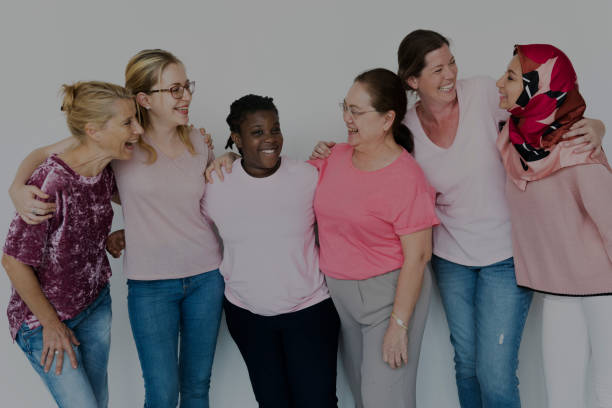 Group of Multiethnic Women Wear Pink Shirt stock photo