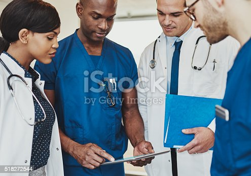 istock Group of multiracial doctors 518272544