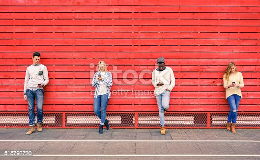 istock Group of multiracial fashion friends using smartphone outdoors 515792720