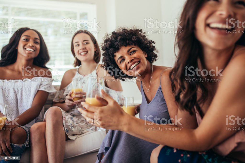 Group of multiracial friends at a party stock photo