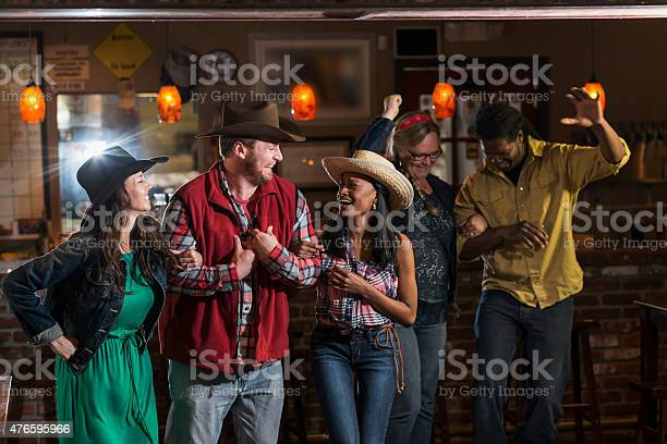 Group of multiracial friends dancing in cowboy hats picture id476595966?b=1&k=6&m=476595966&s=612x612&h=wimp0scjej pwfefvdczsar4pwflwpyejq4rip14mws=
