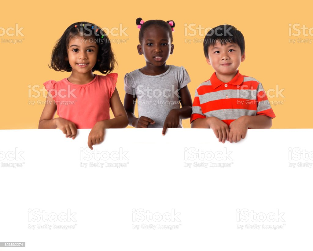 Group of multiracial kids portrait with white board stock photo