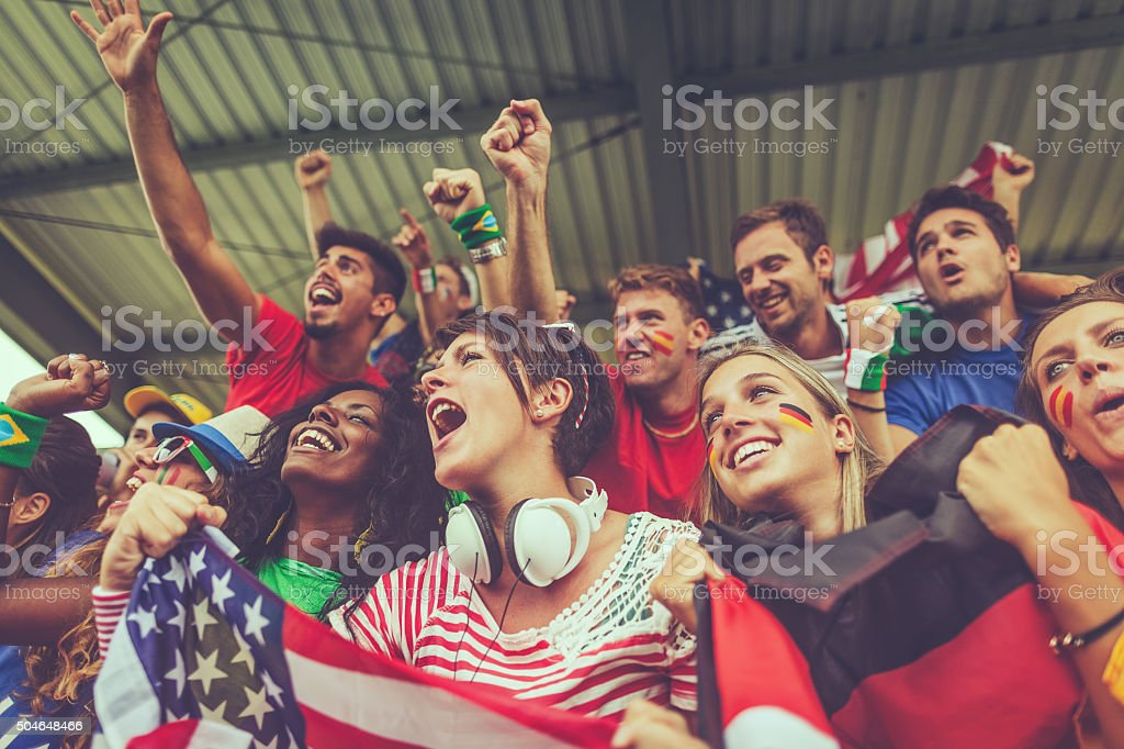 Group of multiracial nations supporters together stock photo
