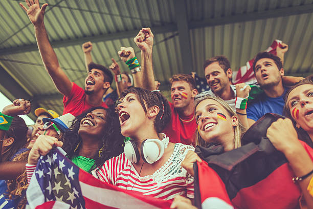 group of multiracial nations supporters together - fan enthusiast stock photos and pictures