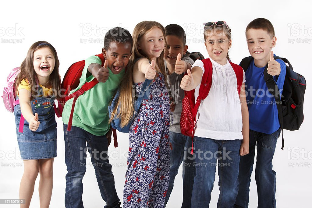 Group of multiracial school children shouting and showing thumbs-up royalty-free stock photo