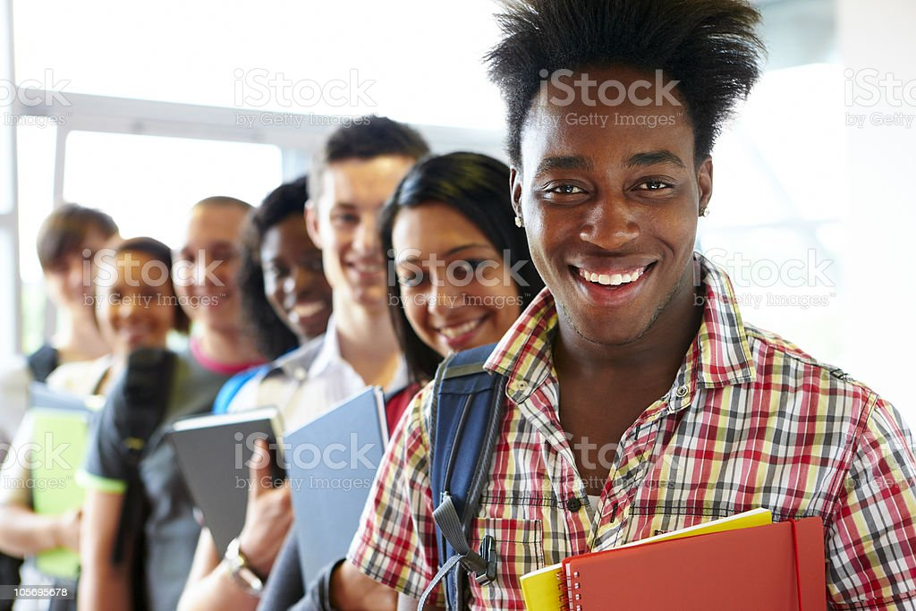 group of multiracial students standing in line smiling royalty-free stock photo