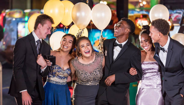 Group of multi-racial teenagers having fun at prom A multi-ethnic group of six teenagers, three multi-ethnic couples, having fun at their high school prom. The two girls are wearing prom dresses and their dates are wearing a suit and tuxedo. prom night stock pictures, royalty-free photos & images