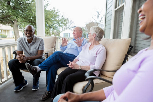 Group of neighbors enjoy one another's company stock photo