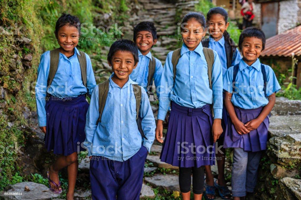 Group of Nepalese school children  in village near Annapurna Range stock photo