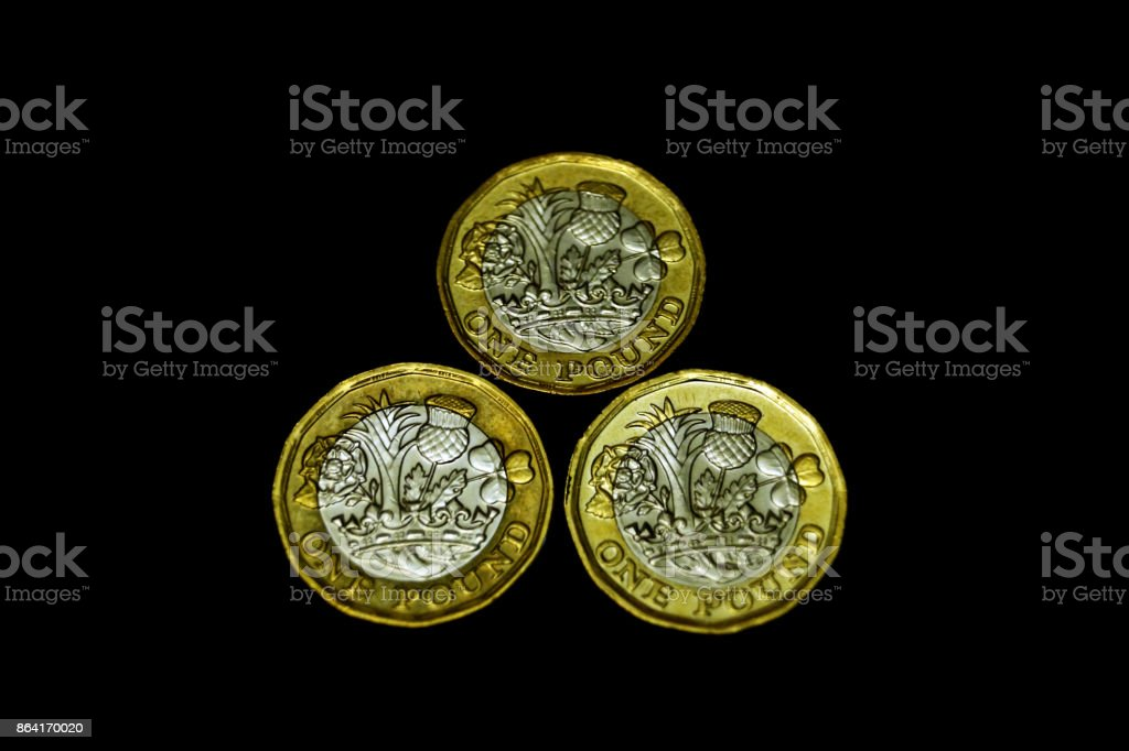 Group of new one pound coins royalty-free stock photo