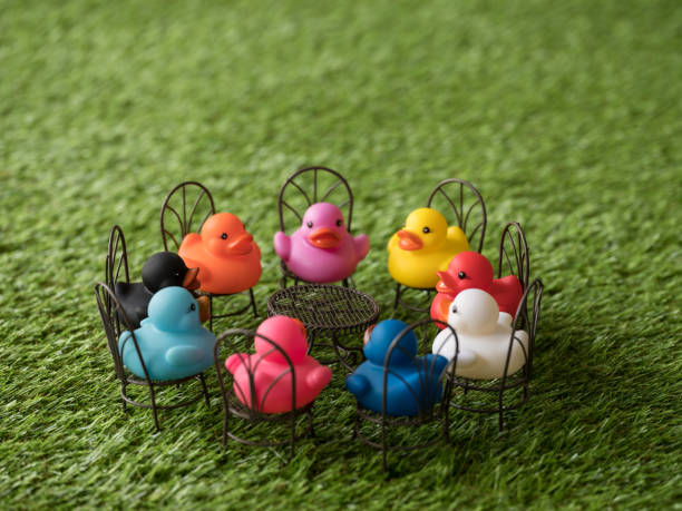 Group of nine different colored ducks on chairs around a table facing picture id922363612?b=1&k=6&m=922363612&s=612x612&w=0&h=benx8ul2veywoboyubvfvdic5bozoanolo2efhiqcrg=