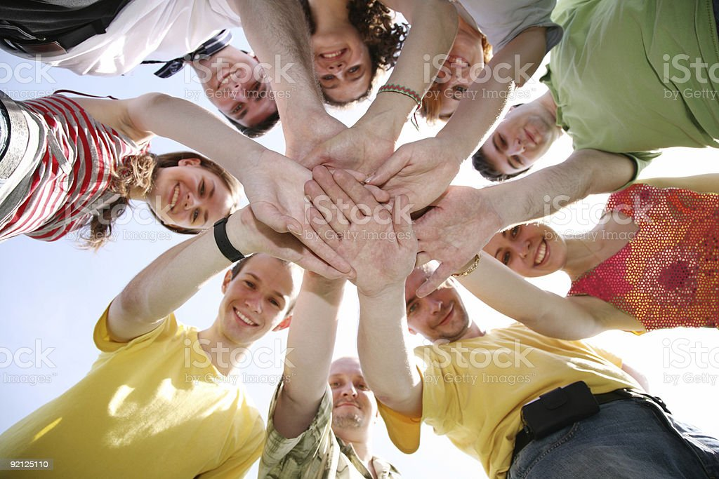 Group of nine friends keep for hands royalty-free stock photo