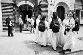 Group of nuns near Armenian Virgin Mary's Dormition Church in Lviv