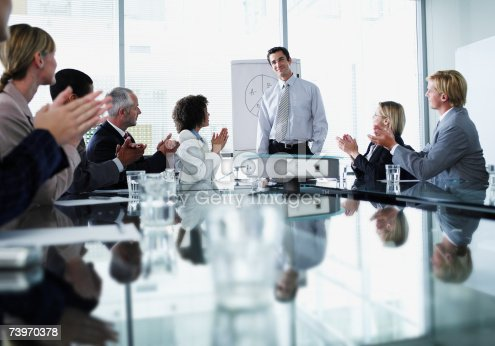 497183120 istock photo Group of office workers in a boardroom presentation 73970378