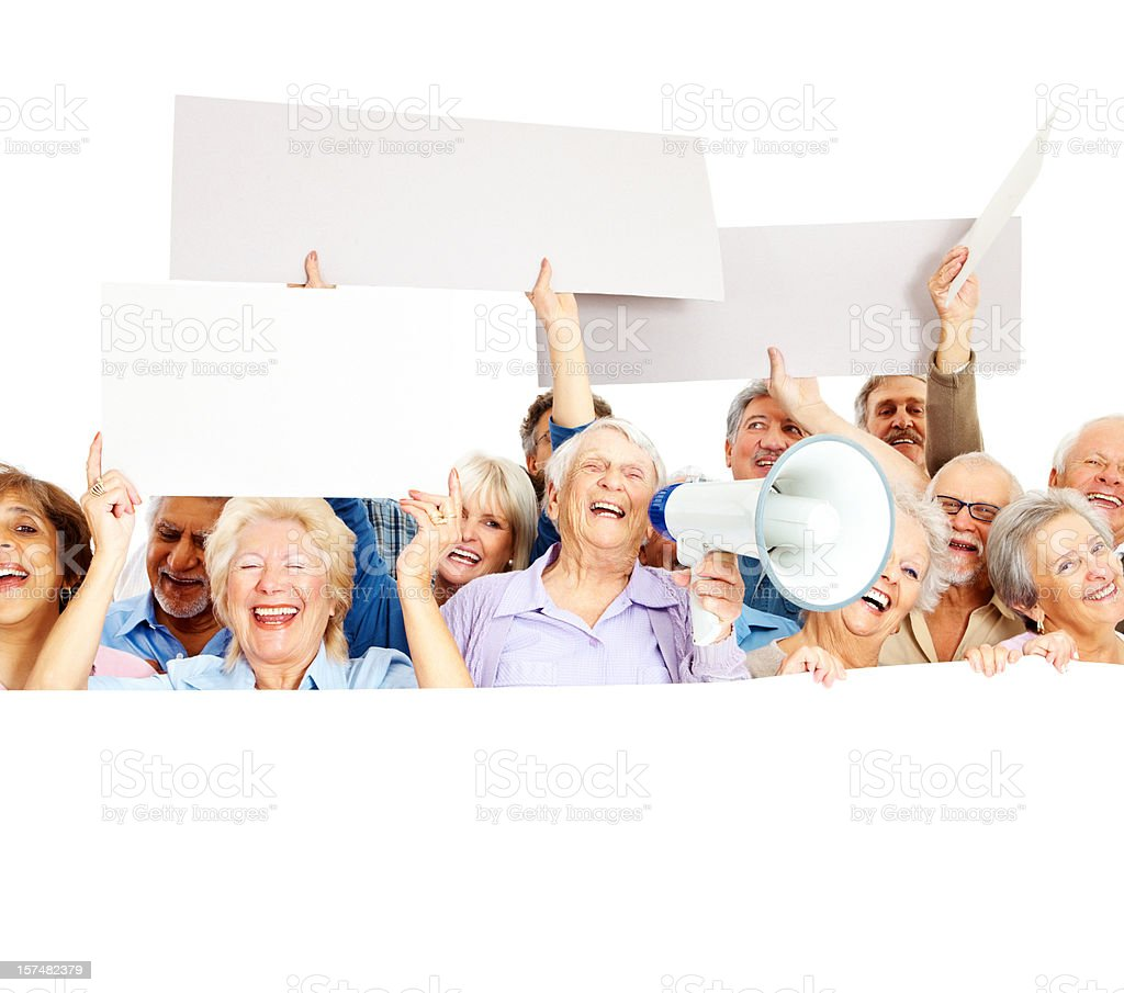Group of old people displaying an empty board royalty-free stock photo