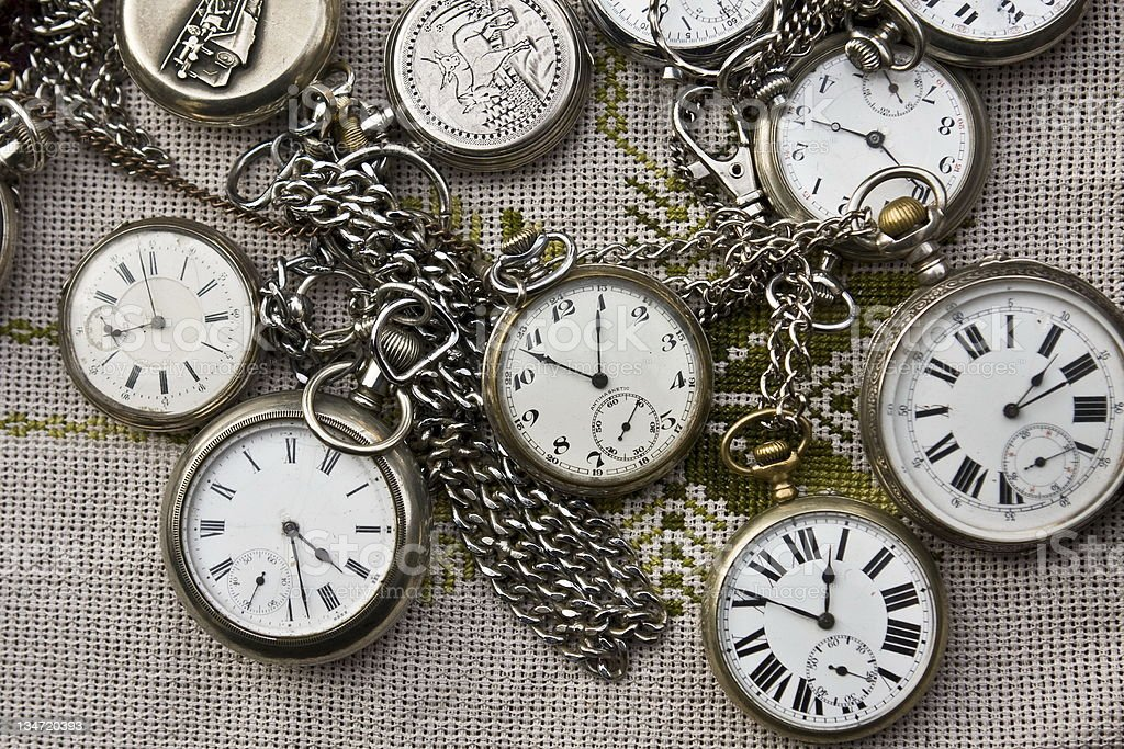 Group of old Pocket watches with chainlets royalty-free stock photo