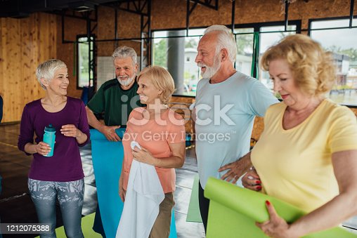 1047537292 istock photo Group of older people having fun after the yoga class 1212075388
