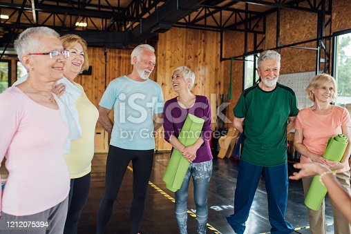 1047537292 istock photo Group of older people talking and relaxing before the yoga class 1212075394