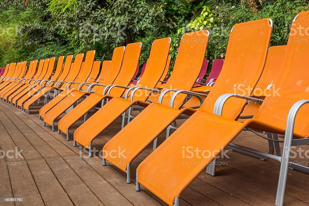 Group of orange deck chairs stock photo