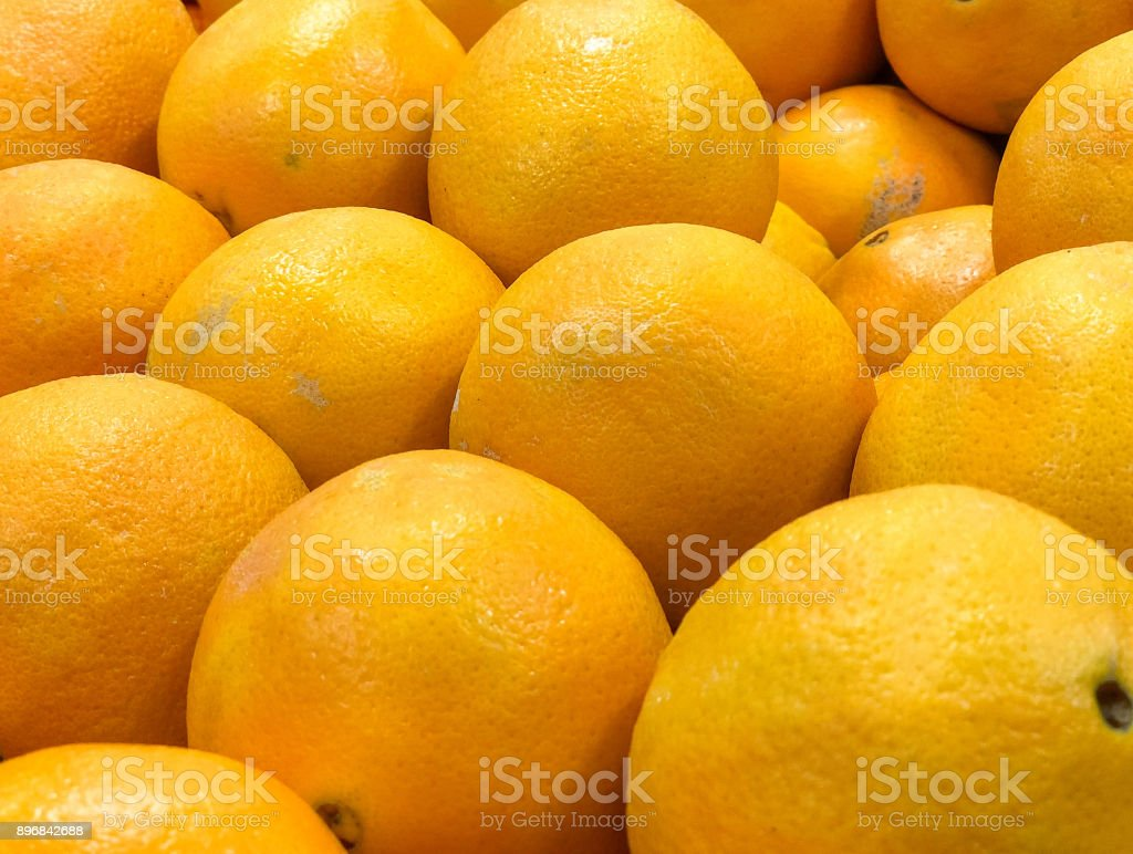 Group of oranges waiting to be picked up at the grocer stock photo