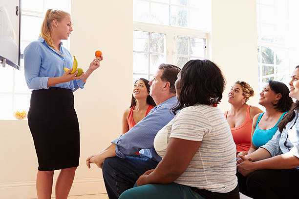 group of overweight people attending diet club - fat nutrient stock photos and pictures