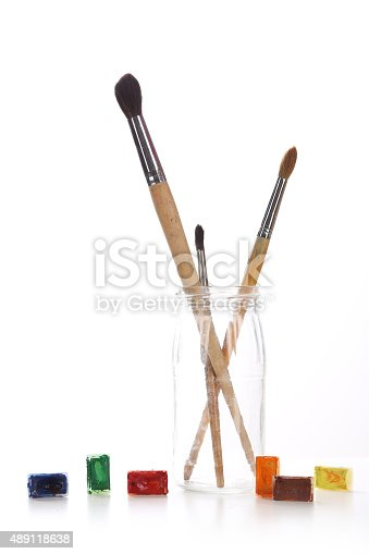 istock Group of paintbrushes in a glass jar and tubes paint 489118638